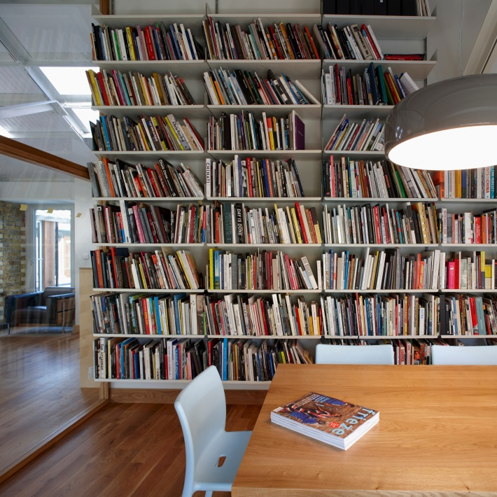 A few bookends would bring more order to this handsome collection of art and architecture books. Fortunately, you can buy them later