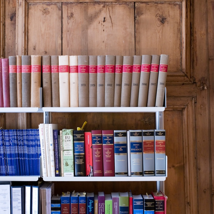 Barrister, solicitor or lawyer? All we know is that they use lots of books and store lots of paper. Thank you. Here the magnificent panelling is treated with due reverence by a semi-wall mounted shelving system.