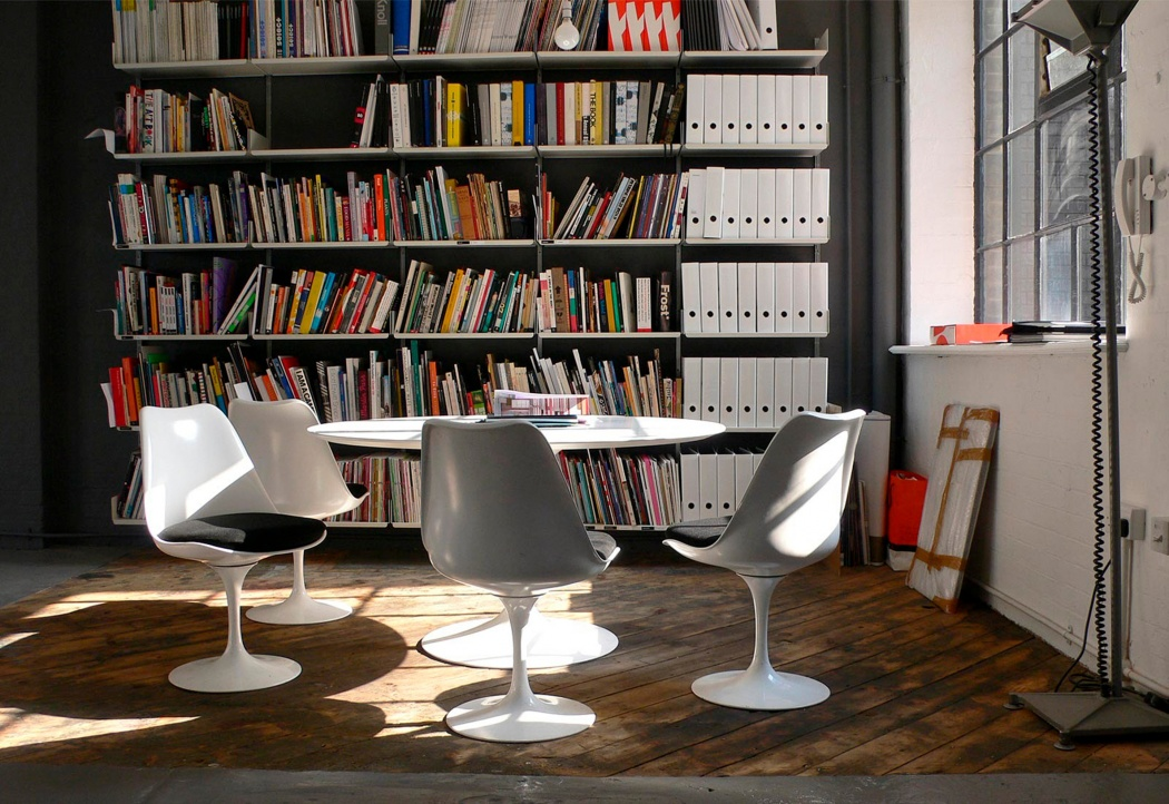Dieter Rams and Eero Saarinen live harmoniously in this graphic design office with large books and folders stored next to the meeting table Courtesy of NB Studio