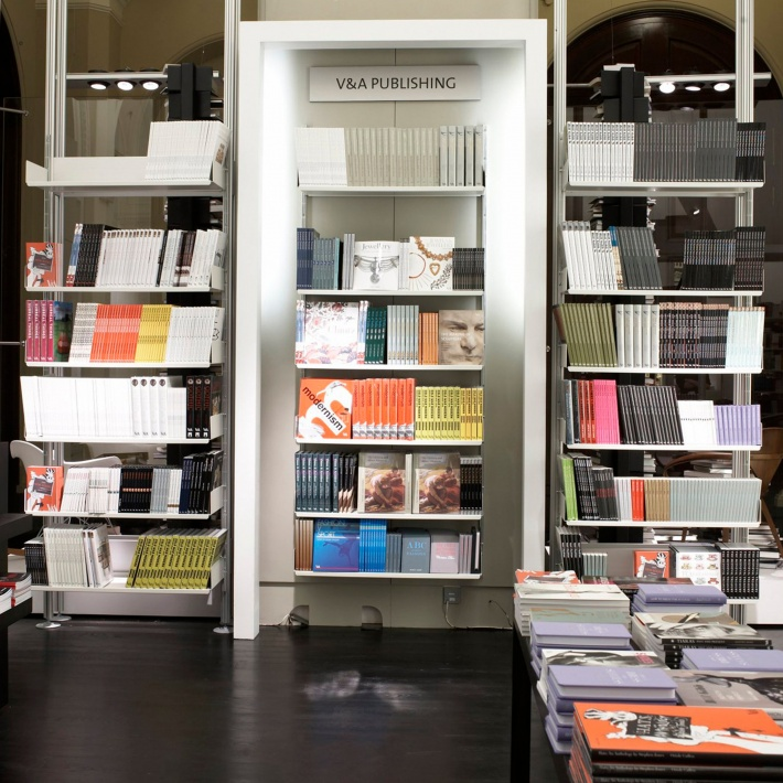 Both wall-mounted (centre) and compressed shelving systems (left and right) accommodate large numbers of books in London's V&A bookshopImages courtesy of the V&A/Holly Jolliffe