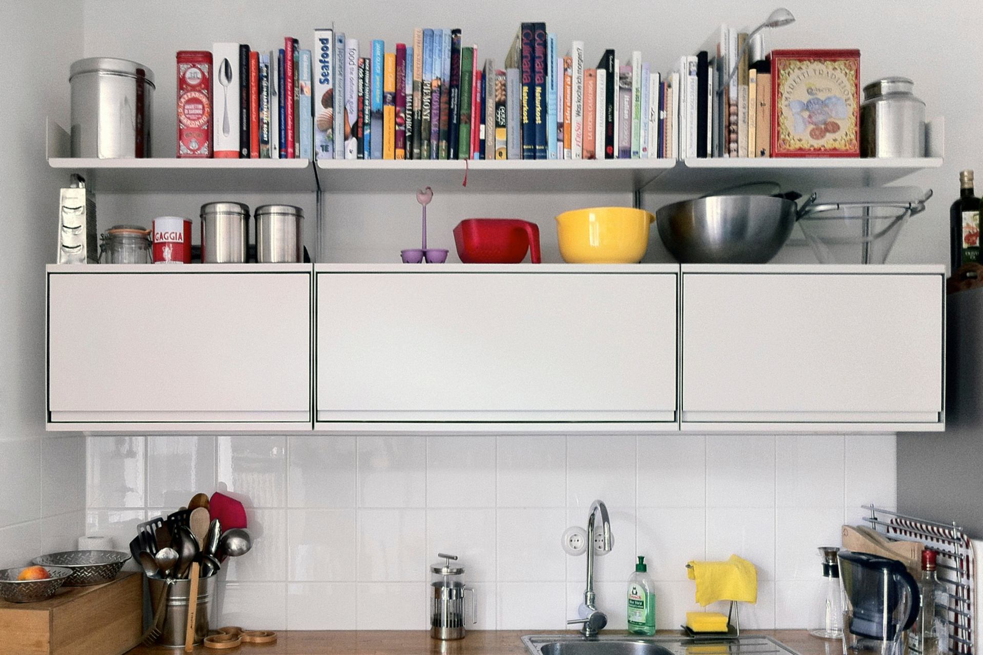 Three cabinets and three shelves. What more does your kitchen need?