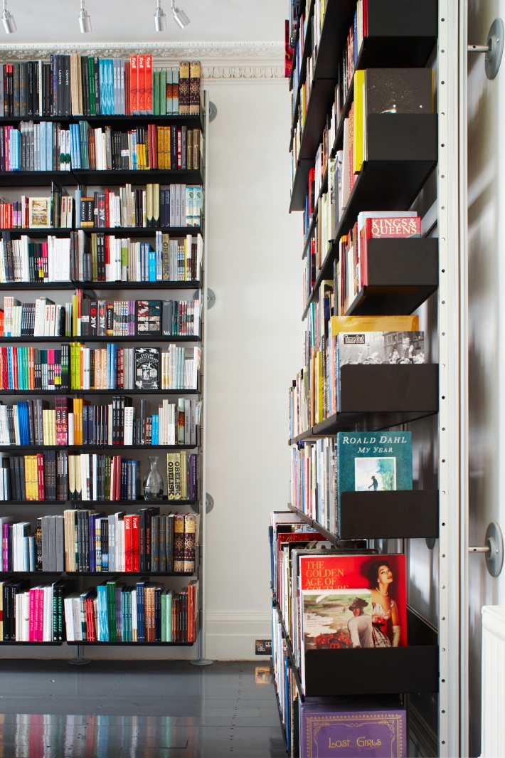 Black bookshelves fit for kings and queens. Note three shelf depths to accommodate all types of books