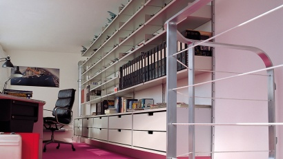 Hide office paraphernalia away in cabinets leaving the shelving for display and file storage