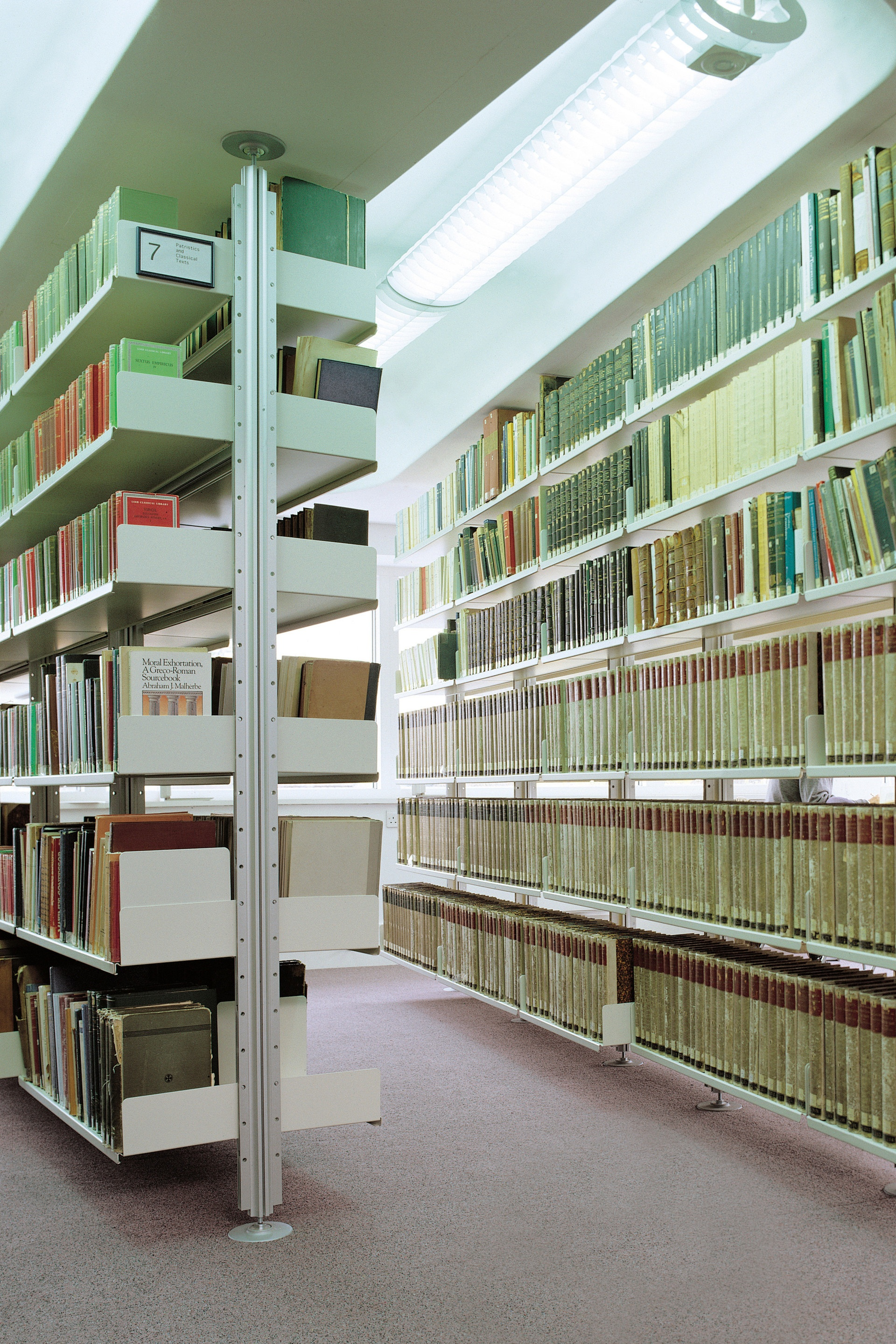 The demands of a university library are met by the shelving system compressed between (concrete) floor and ceiling