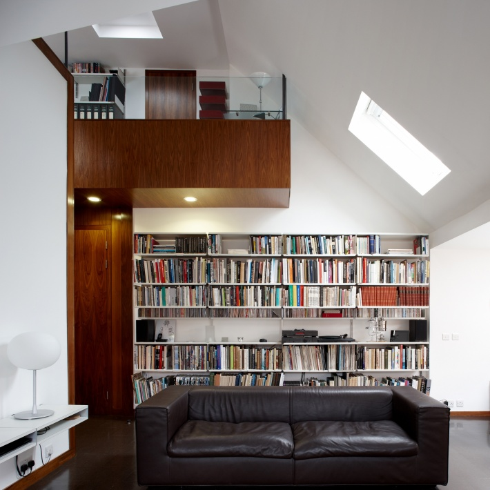 Double shelves on short tracks form a credenza or sideboard to the left; shelves in the background and upstairs are working hard