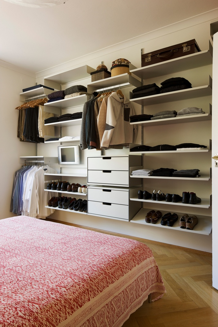 The shoes, clothes and hat storage solution for your bedroom. Note the hanging rails for shirts and trousers. Even the TV is squeezed in for bedtime viewing. Some people cover the system with roller blinds; others do not