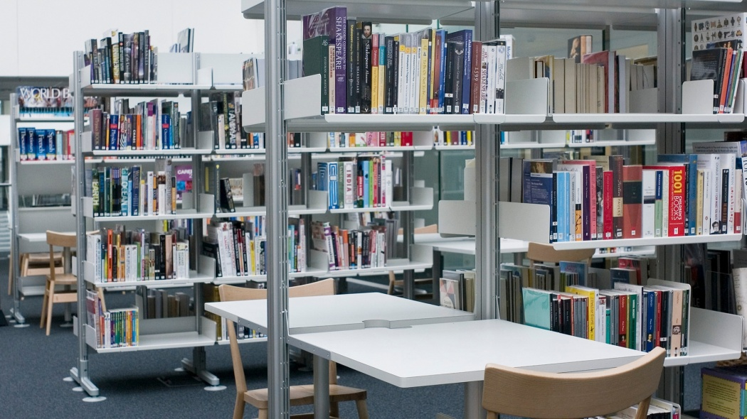 Study areas were created within the library by adding desks directly to the shelving system