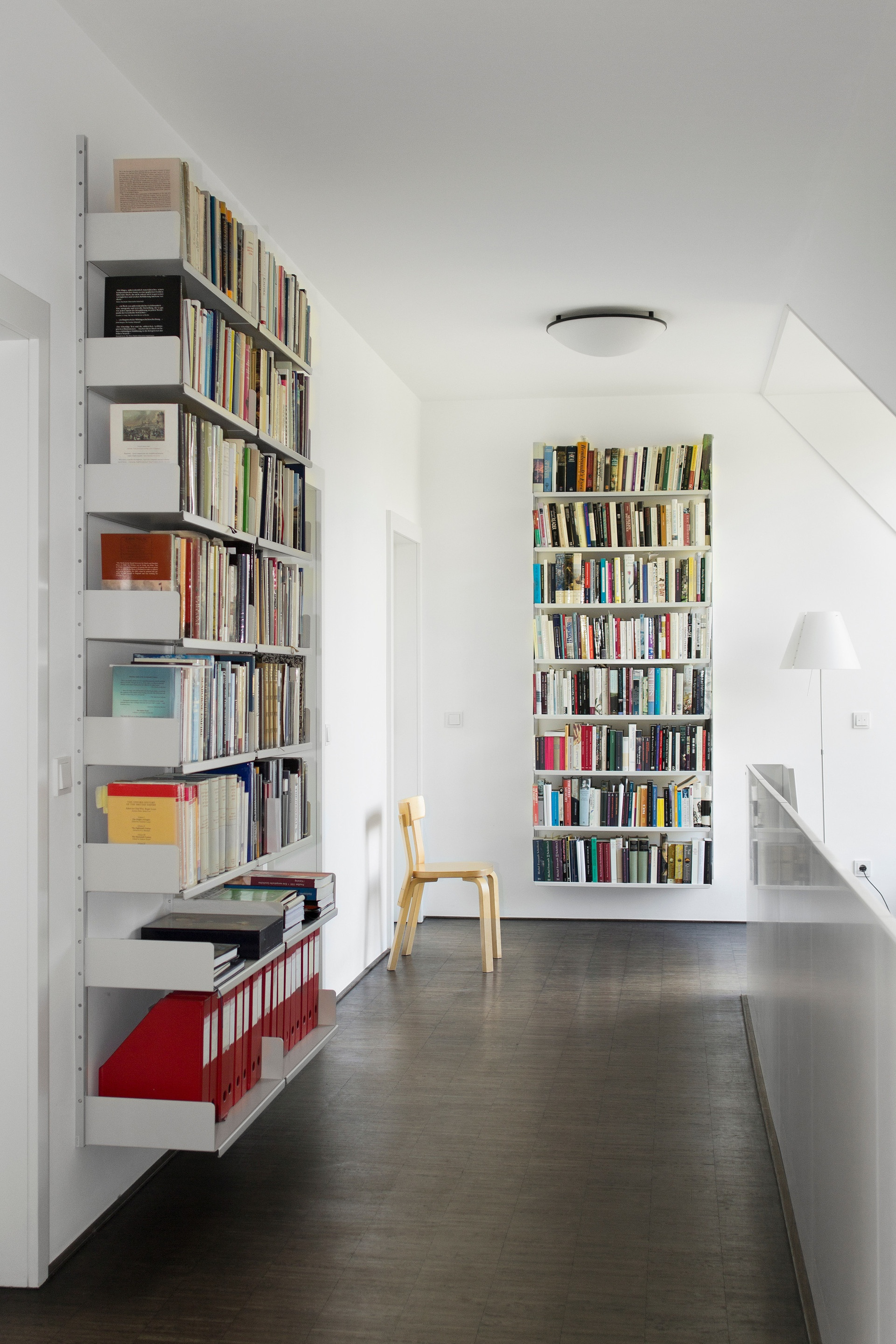 Books over art. This customer's library makes fine use of a first-floor landing.  See more ways to make use of a hallway