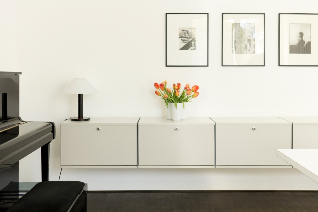 A simple arrangement of fold-down-door cabinets is a secure sideboard for any room.