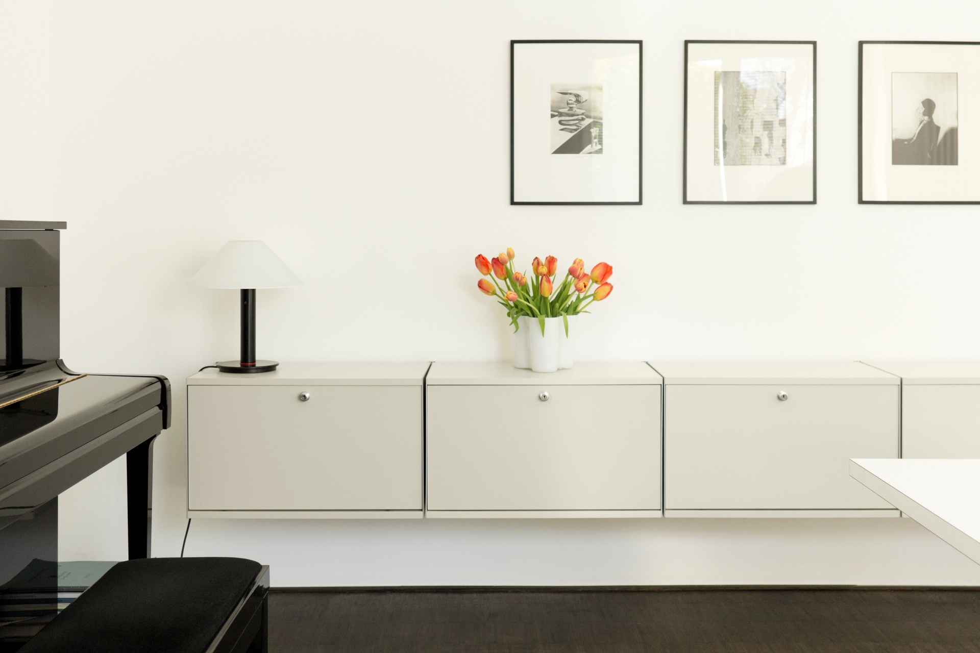 A simple arrangement of fold-down-door cabinets is a secure sideboard for any room