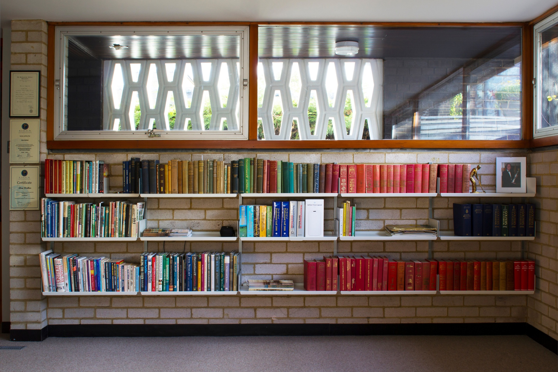 A bookish bunker with the 606 Universal Shelving System wall-mounted on exposed brickwork. Apt.