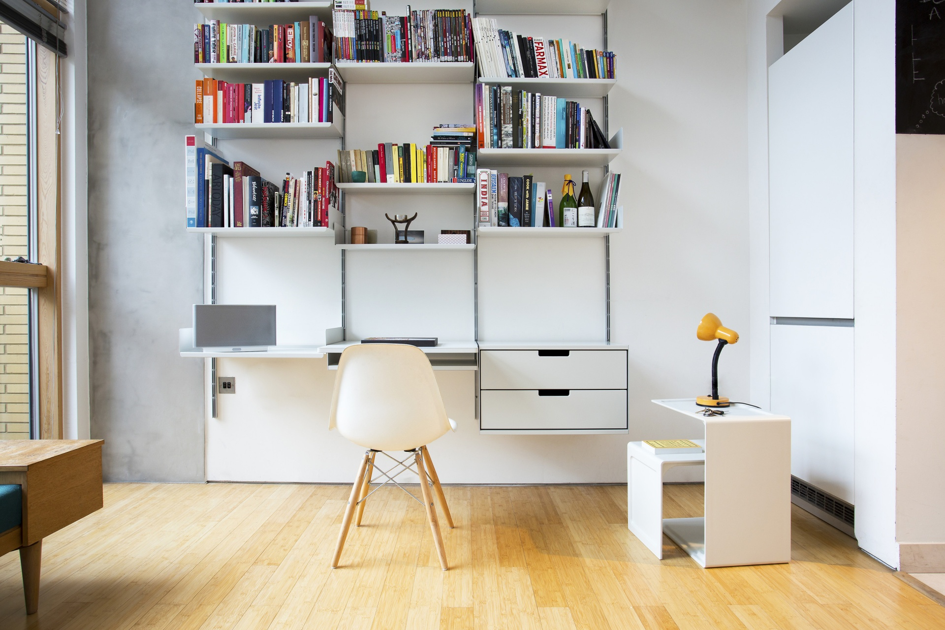 The central desk shelf provides the work surface; the two-drawer cabinet keep things tidy; the 621 Table provides illumination