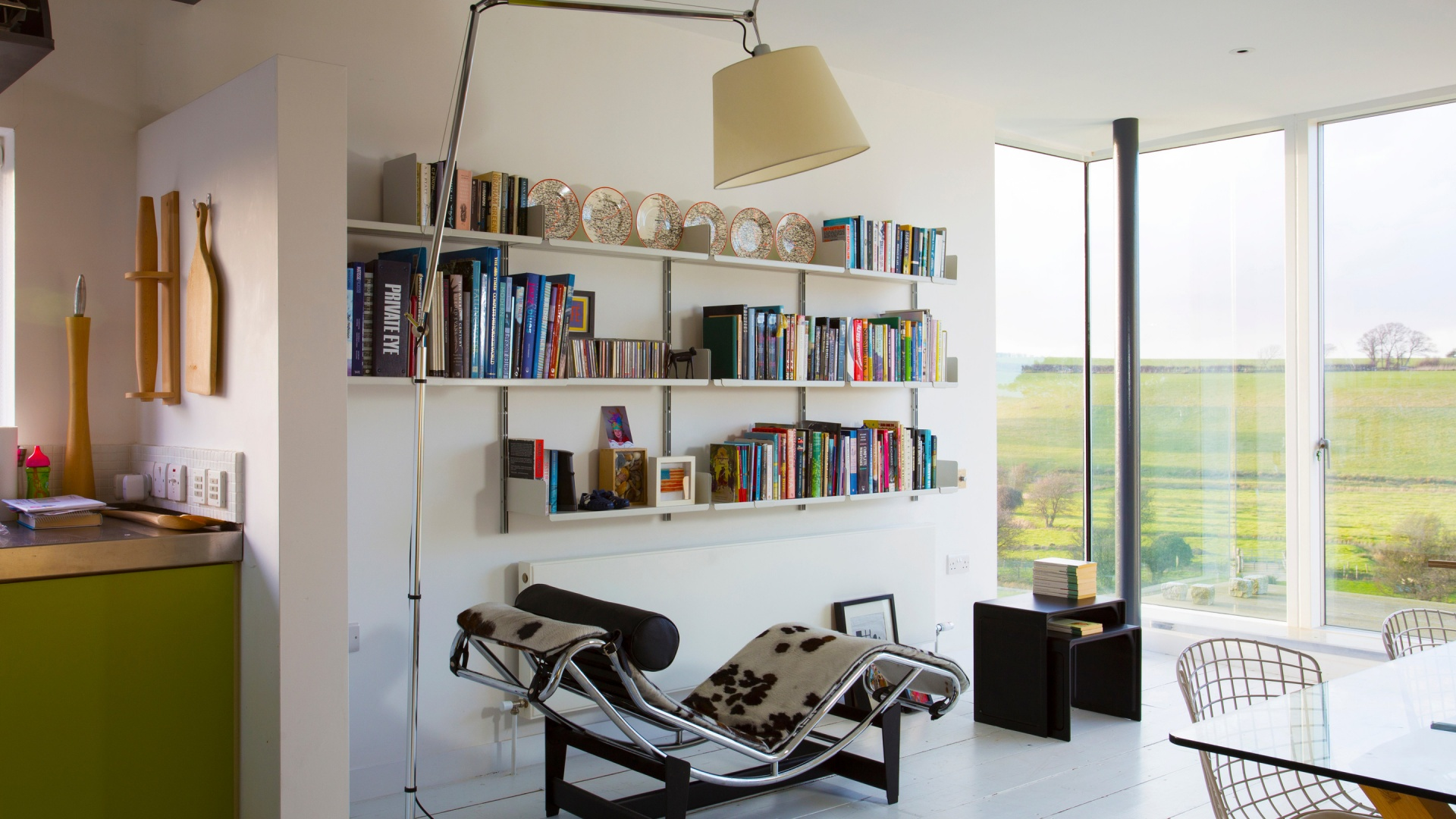An invitingly open library above a radiator. Favourites picked out on the black 621 Table