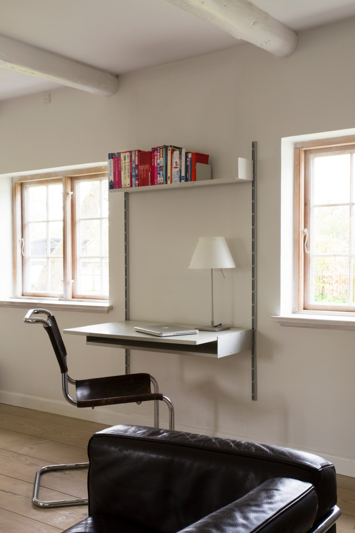 This workspace comprises just one metal shelf, one desk shelf and two E-Tracks. Yours for $943