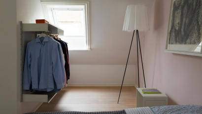 Make use of awkward areas in your bedroom. Here we see shirts picked out for the week on a hanging rail. Bedside table: 621 Table