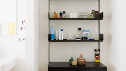 The 606 Universal Shelving System is also available in black. In a bathroom…