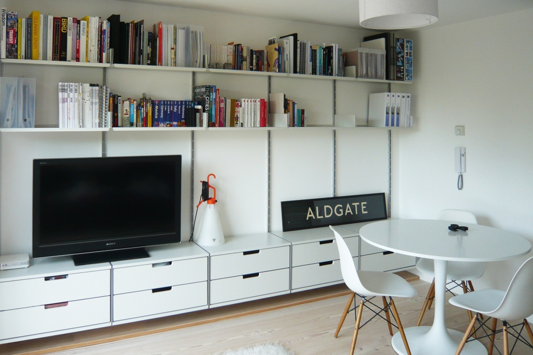 Heavier TVs that are not wall-mounted can be placed over two cabinets to spread the load