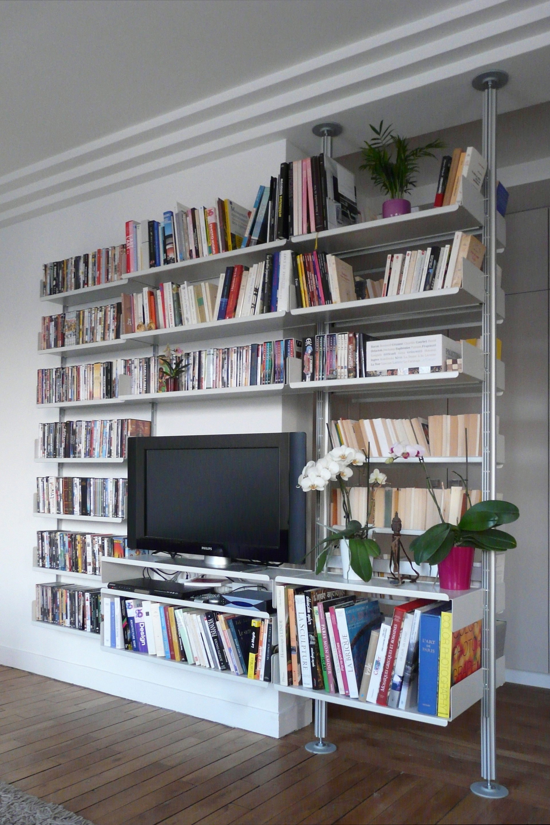 Shelves run on when walls run out: this system moves from wall-mounted on the left to compressed on the right. Clever