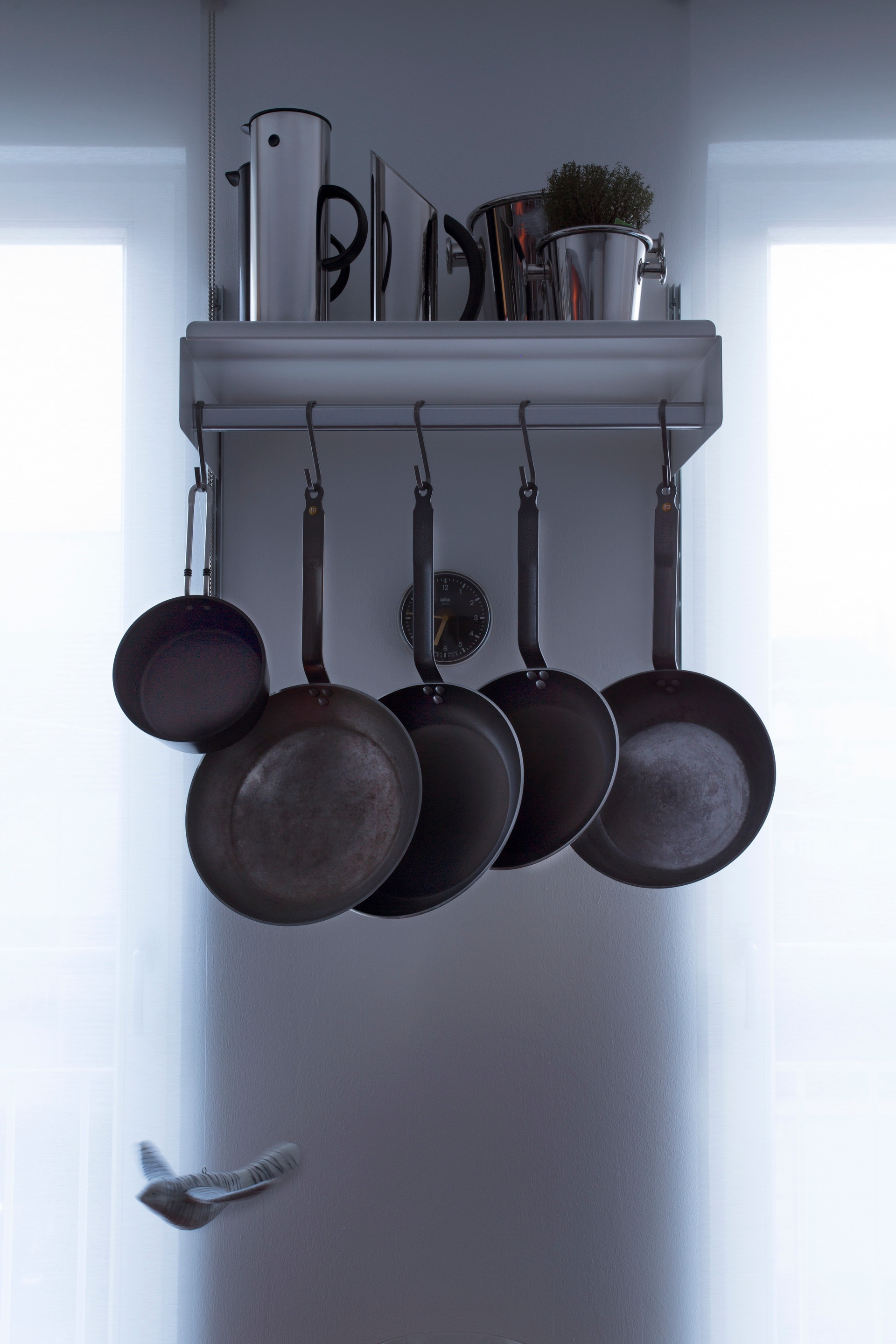 Use our hanging rail for pots and pans. It can be used for coats in other areas of your home too