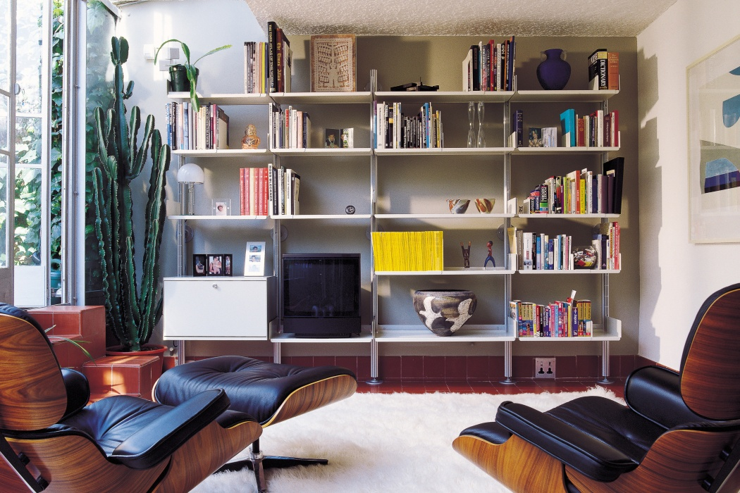 Classic semi-wall mounted shelving that respects a home of architectural distinction