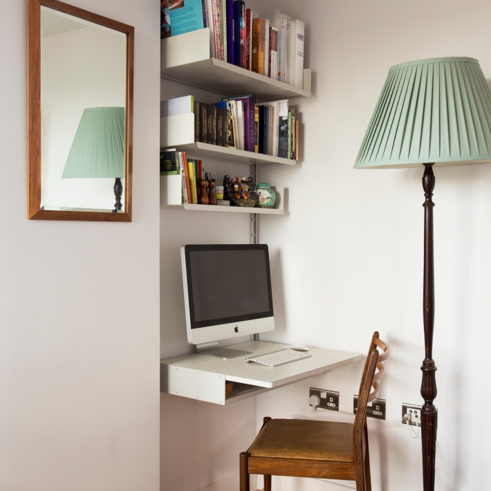 A tight alcove becomes a workspace; the desk shelf and iMac are at home