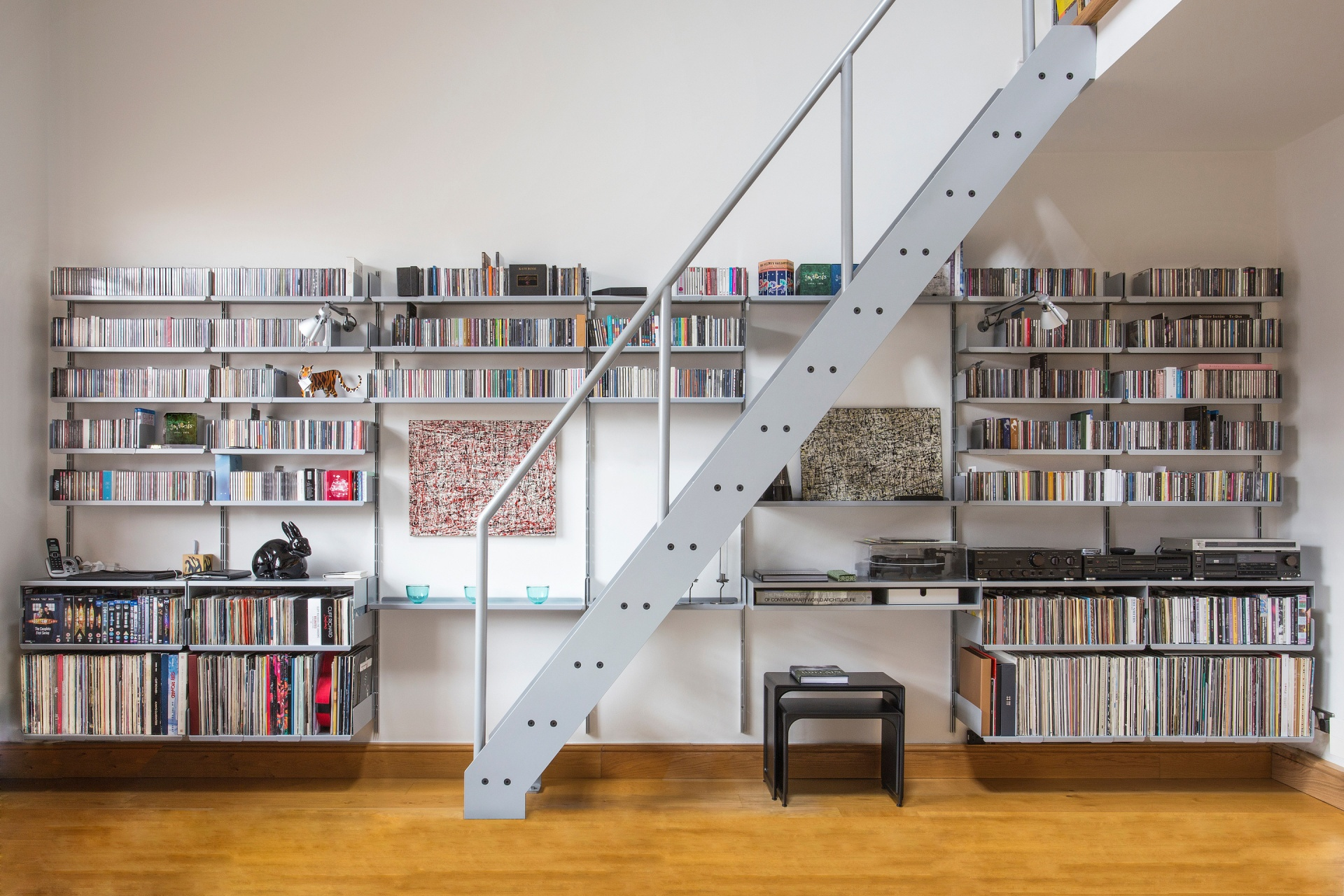 "7"" and 12"" vinyl together with CDs; flipped shelves and a double shelf accommodate the hifi separates. Our meticulous free planning service allows this to happen"