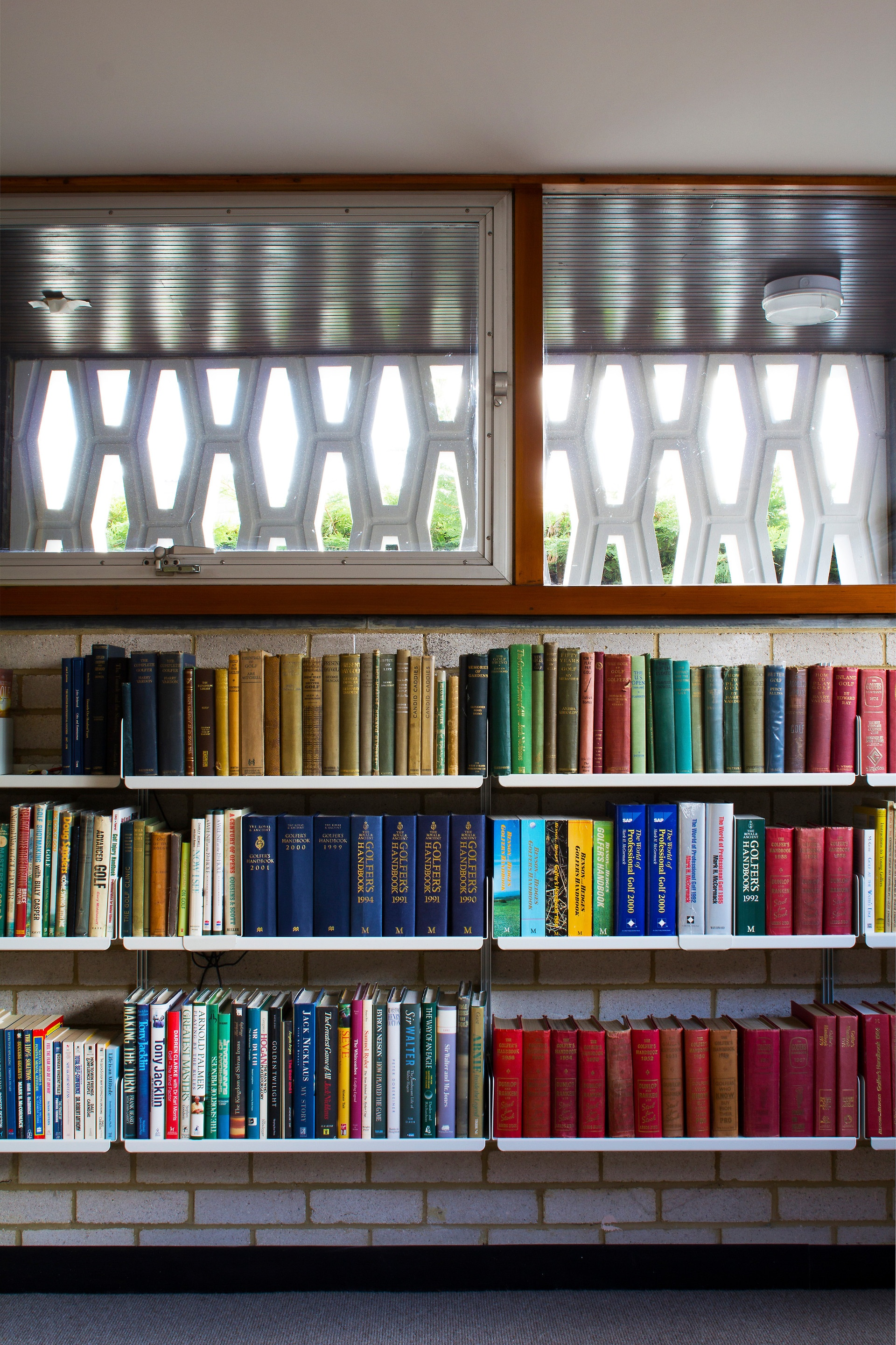 A bookish bunker with the 606 Universal Shelving System wall-mounted on exposed brickwork. Apt