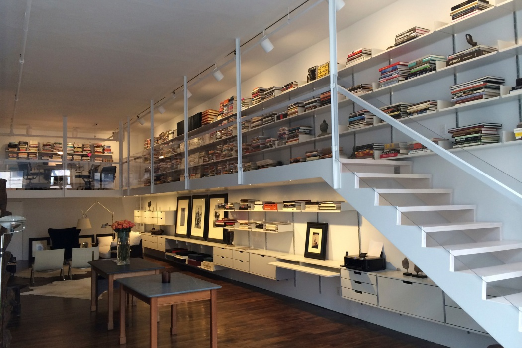 Pictures on shelves; books horizontally; cabinets above cabinets; meticulously planned by a Vitsœ planner for this New York loft