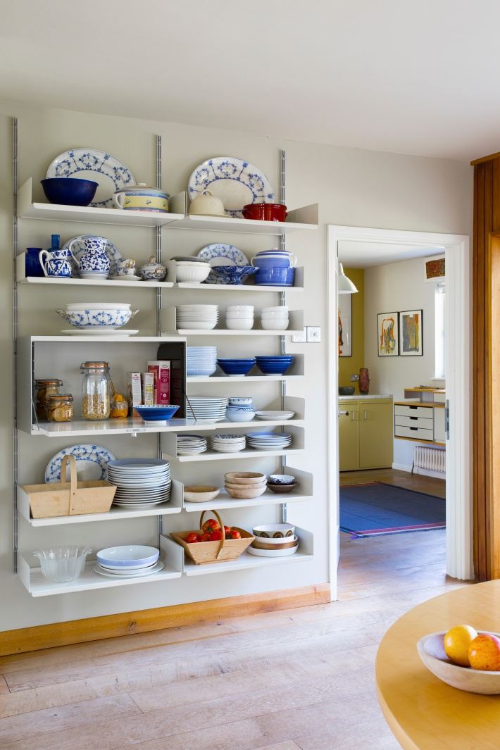 The fold-down door cabinet on the left stores breakfast cereals while providing a serving counter for the bowls