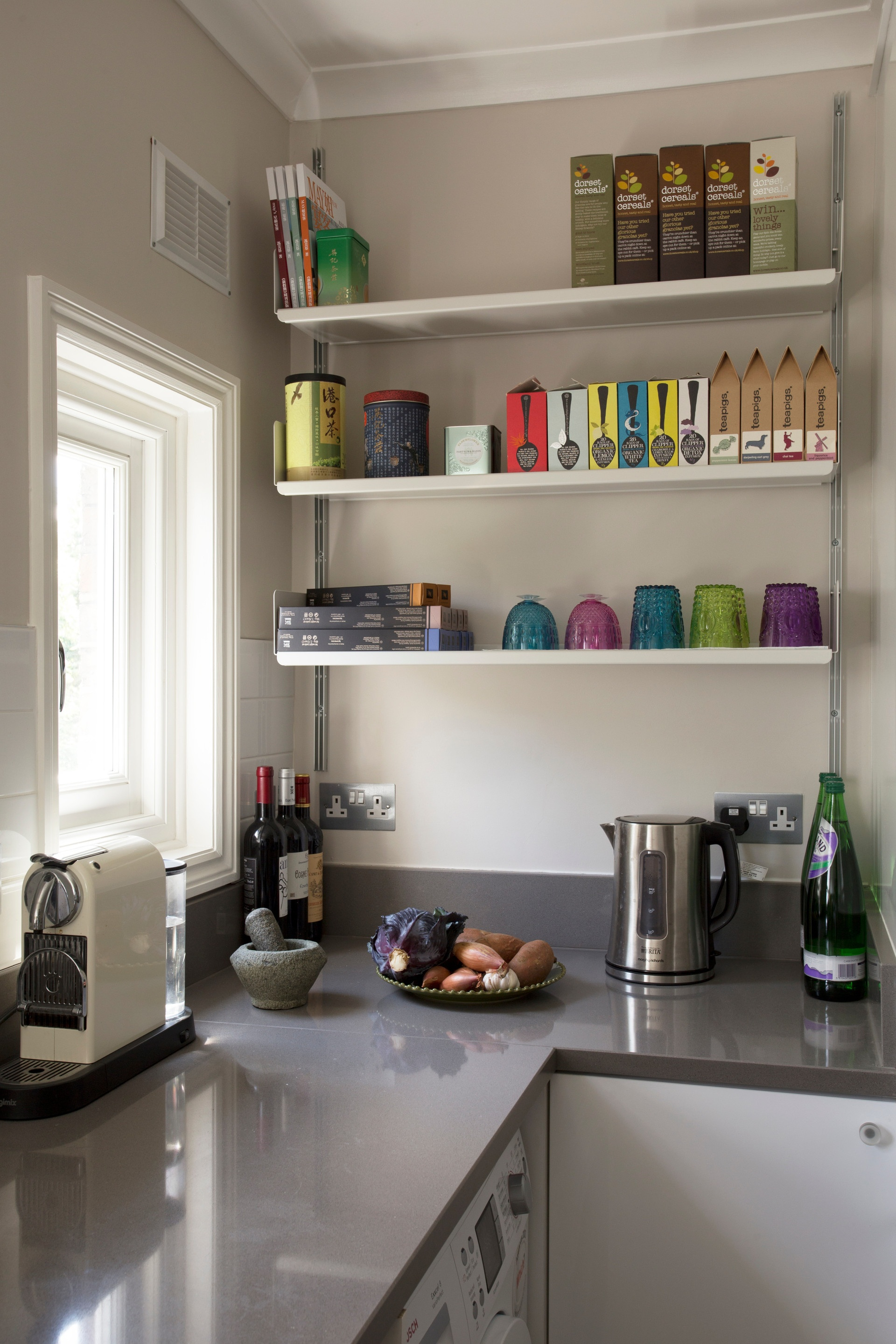 Open shelves replace the heaviness of a kitchen cabinet