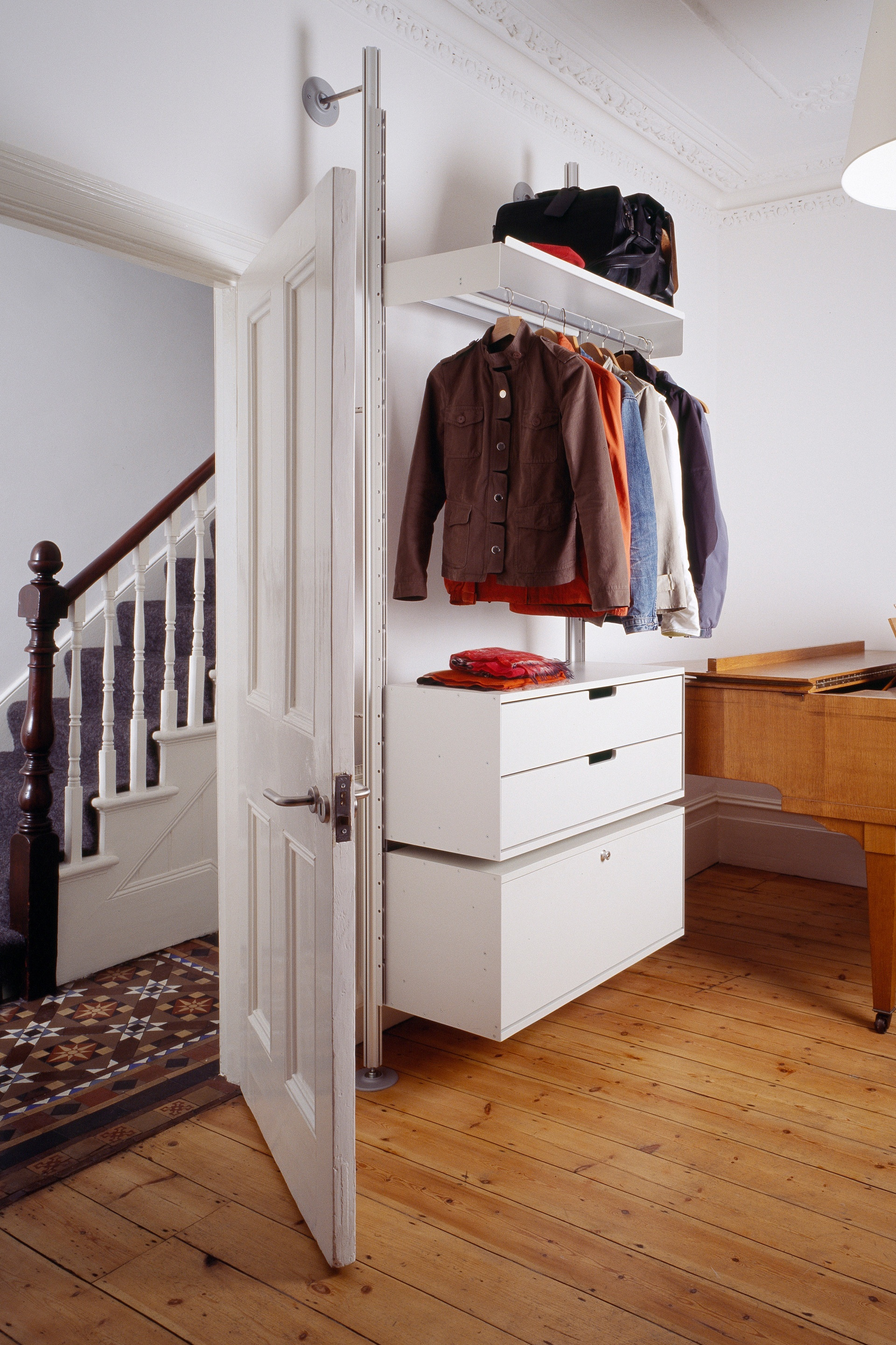 In a tight space where organisation is key, cabinets can be hung on top of each other