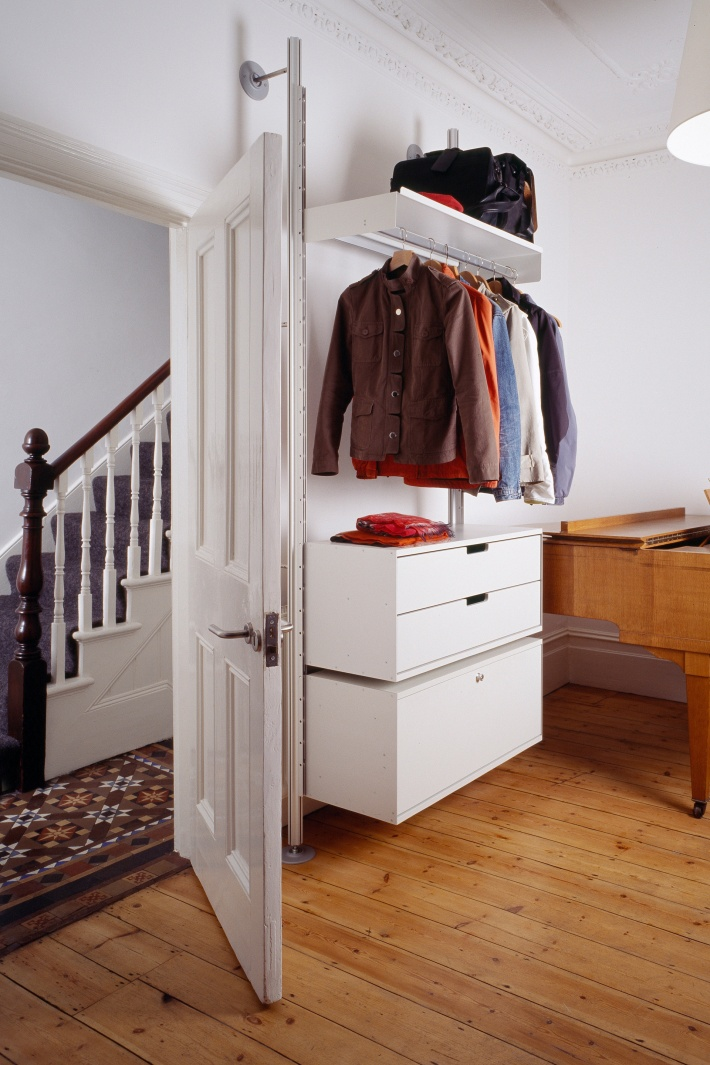 In a tight space where organization is key, cabinets can be hung on top of others