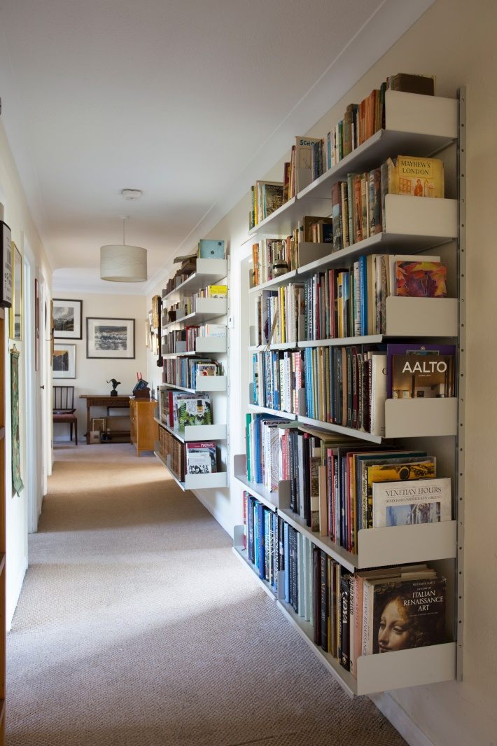 A narrow hallway easily accommodates a large library