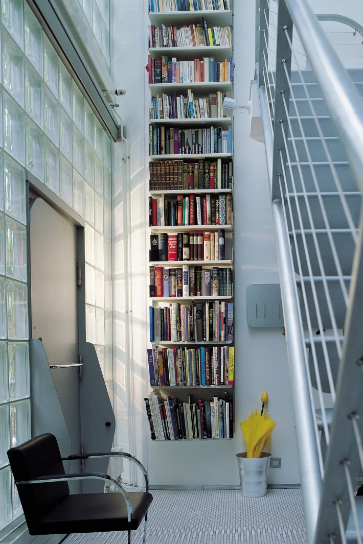 If your hallway is vertical rather than horizontal – and you have some stairs – your library can find a home