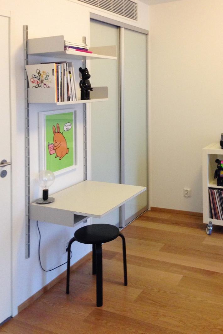 A desk shelf provides the perch for homework
