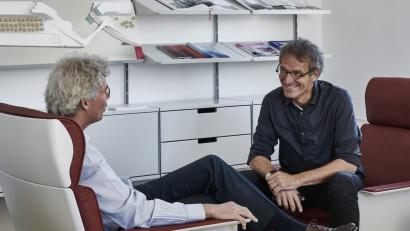 Schneider and Schumacher talk in 620 chairs