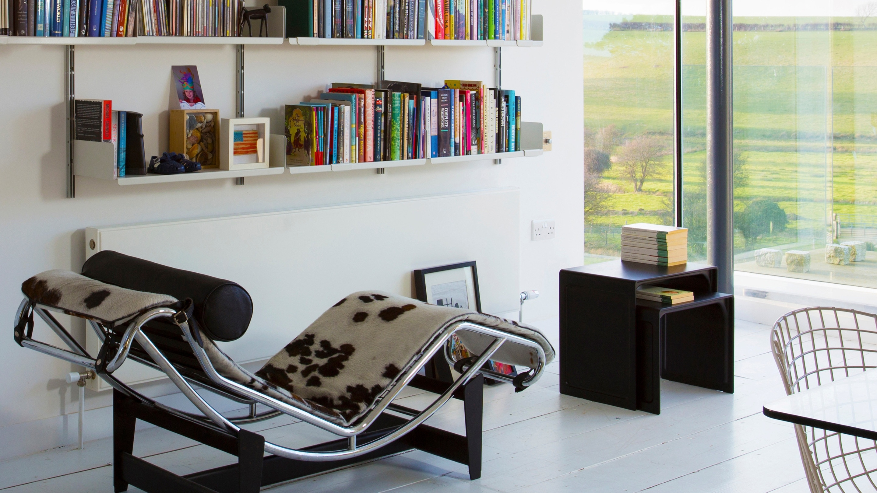 A nesting pair of black side tables, with the classics in the countryside