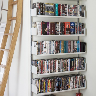 strong metal shelves for DVD large collection. Vitsœ 606 modular shelving system. Designer Dieter Rams