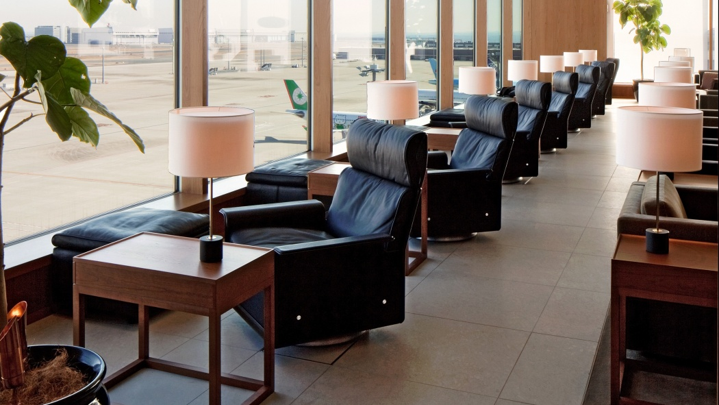 A bank of high-back 620 chairs with swivels and footstools await discerning travellers