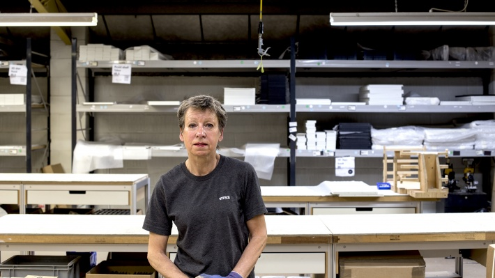 Sandy at the 606 Universal Shelving System cabinet assembly area of the Vitsœ workshop in 2017