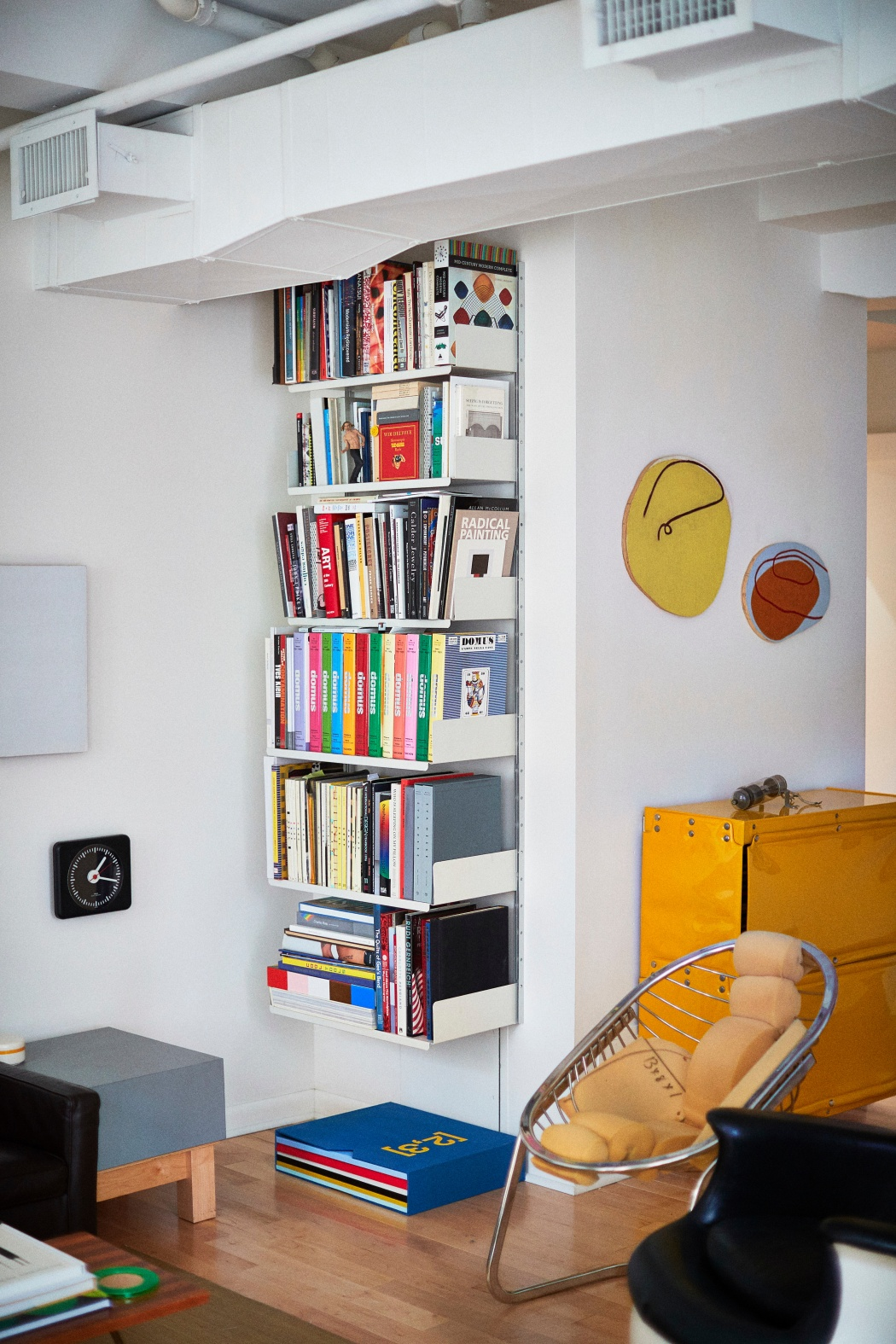 Sue and Alan Ravitz's 606 Universal Shelving System and Otto Zapf Softline Series storage system in New York
