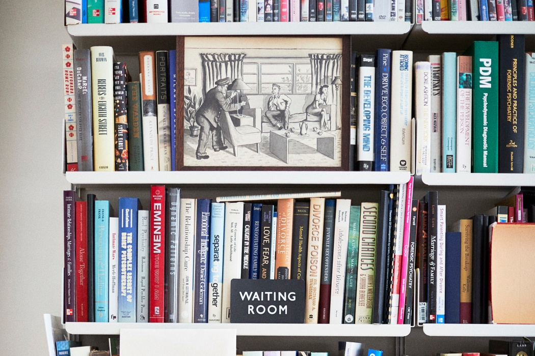 Alan's mementoes in front of books on his Vitsoe 606 Universal Shelving System in New York