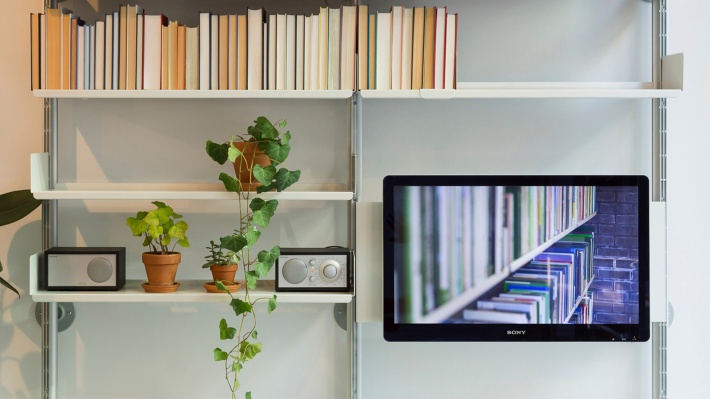 TV/ computer screen mounted panel. Modular shelving system with bookshelves. Wood lacquered in white