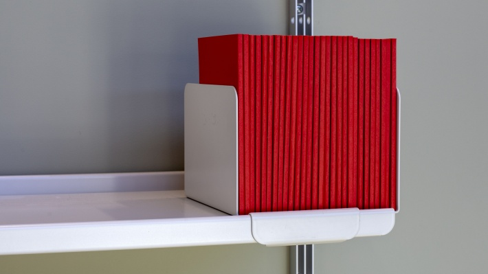 high quality metal bookend for books, vinyl record upright best storage position. Vitsœ shelving. Designer Dieter Rams