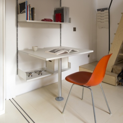 Shelving above desk for home office, modular strong metal. Minimalist studio design. Designer Dieter Rams