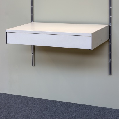 Strong metal shelves with drawer. Modular shelving.designer Dieter Rams