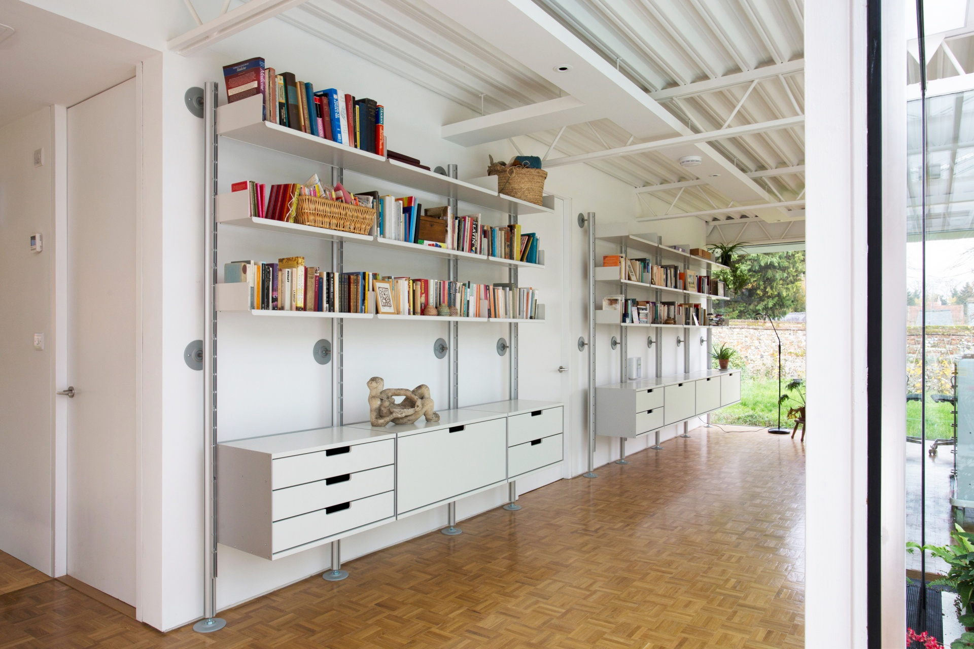 Hallway with 606 Universal Shelving System