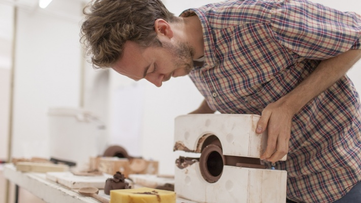 Ian McIntyre in his studio removing the mould from a prototype Brown Betty
