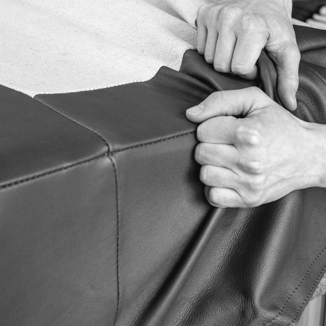 Armchair or sofa upholstery demonstration. Replacement of linen and leather upholstery is available for the designer 620 Chair