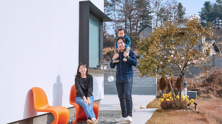 Sairom and PJ Lee's outside their family self-build home in South Korea.